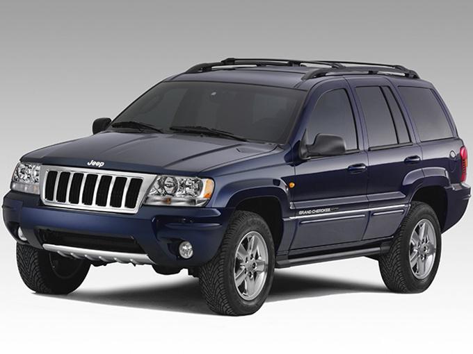【ジープ グランドチェロキー(2代目)】ジープの最上級モデル。エクスプローラー同様、ラダーフレーム構造(※2)が採用されている。4Lの直6と4.7LのV8エンジンがあり、一部グレード(リミテッドV8)には一輪でも地面に接していれば走行できるという「クォドラドライブ4WD」を装備。総額100万円以下で走行距離5万km前後が十分見つけられる